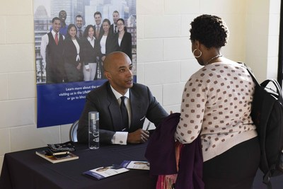 Nightline co-anchor Byron Pitts signs autographs at Bunker Hill Community College.