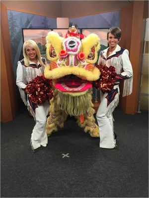 Denver Broncos Cheerleaders Faymie and Sam with a traditional Chinese lion dance promoting the upcoming Cathay Pacific Chinese New Year festivities in Hong Kong during a media tour in Denver, Colo. Photo credit: Shawna Peters.