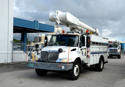 Florida Power & Light Company crews depart West Palm Beach Service Center as part of the ice storm travel team supporting utilities in Arkansas and Texas on Dec. 5, 2013 in West Palm Beach, Fla.  (PRNewsFoto/Florida Power & Light Company)