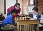 Just days before the U.S. Chess Championships begins in St. Louis, St. Louis Cardinals manager Mike Matheny partners with the Chess Club and Scholastic Center to help promote chess. In this photo, Matheny, an avid chess player, is joined with Sam Jerauld and Jaylen Kaid for a chess lesson at the club.