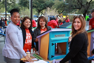 Houston volunteers and Rebekah Manley of the Texas Center for the Book show off their newly built Little Free Library. Photo credit: Stephen Siwinksi, TSLAC