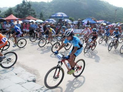 Fuquan County, Guizhou Province: Mountain Bike League Players Fighting in Pear Garden