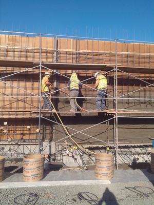 Jos. J. Albanese crew members applying Central Concrete mixes via wet-mix shotcrete process at San Jose's Zero Waste Energy Development Facility. Not only did this process allow larger volumes to be placed in less time, but the ability to adjust the water allowed the team to meet the hardening properties required for the job.  (PRNewsFoto/Central Concrete Supply Co., Inc.)