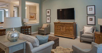 The living rooms at Arbor Terrace provide an upscale homelike setting.