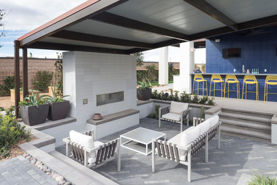 An outdoor living space with fireplace.