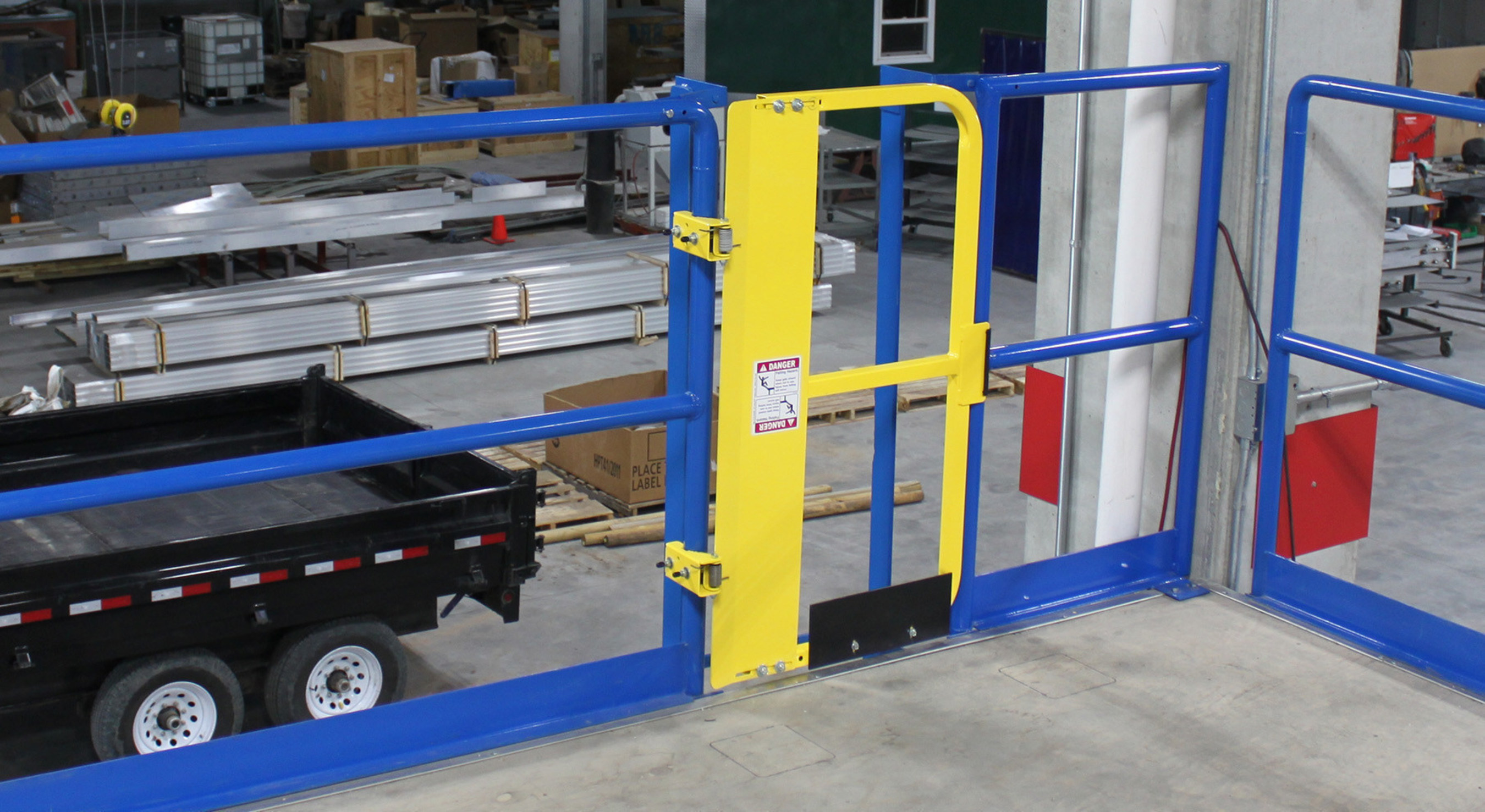 "The Full Height Ladder Safety Gate from PS DOORS provides a 42"" top rail, mid-rail and 5"" safety toeboard for increased personnel protection."