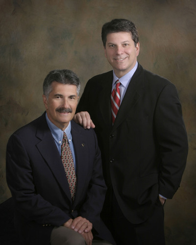 Drs. Harlan and Todd Pollock (left to right). (PRNewsFoto/Texas Institute for Surgery) (PRNewsFoto/TEXAS INSTITUTE FOR SURGERY)