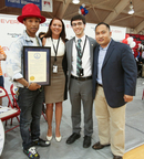 Representatives from the office of Virginia Governor Terry McAuliffe and Virginia Delegate Ron Villaneuva present a proclamation naming June 7 as Pharrell Williams Day across the Commonwealth of Virginia. (PRNewsFoto/EverFi, Inc., Keith Cephus)