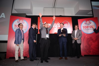 Peter Garnica of Batavia, Illinois raises his arms in celebration after being named as the top restaurant General Manager (GM) in Wendy's global restaurant system with almost 6,500 restaurants.  Garnica was recognized this week at Wendy's first Top GM Conference in Dublin, Ohio.
