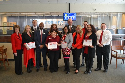 """Pictured celebrating the success of the """"Go Red for Women"""" campaign at Astoria Bank's Shirley Branch, left to right, are: First VP/Director of Relationship Banking Susan Ring, Operations Supervisor Agnieszka Grela, Shirley Branch Manager David Wilson, Universal Banker Dillon Cummings, Licensed Personal Banker Claire Preston, Senior Licensed Personal Banker Deborah Pasolini, Assistant Branch Manager Kazi Arzuni, VP/Regional Manager Jeffrey Cooper, Administrative Assistant Alexis Latino (representing the AHA/ASA), Branch Tellers Nicholas Grasso, Brianna Marco and Joseph Doyle."""