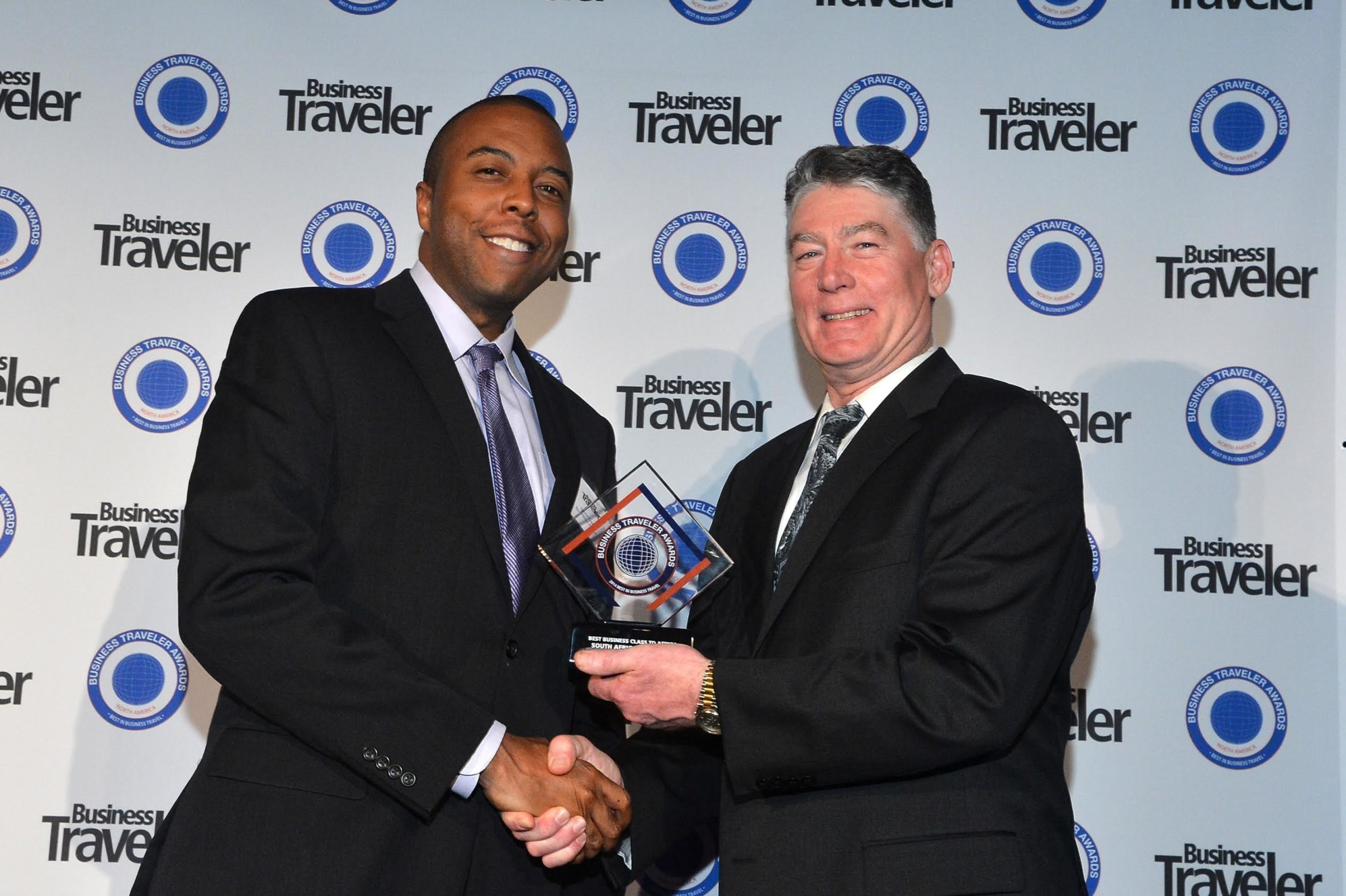 Damion Rose, Manager Marketing Promotions for South African Airways receiving the awards from Jerry Allison, Group Publisher at Business Traveler.