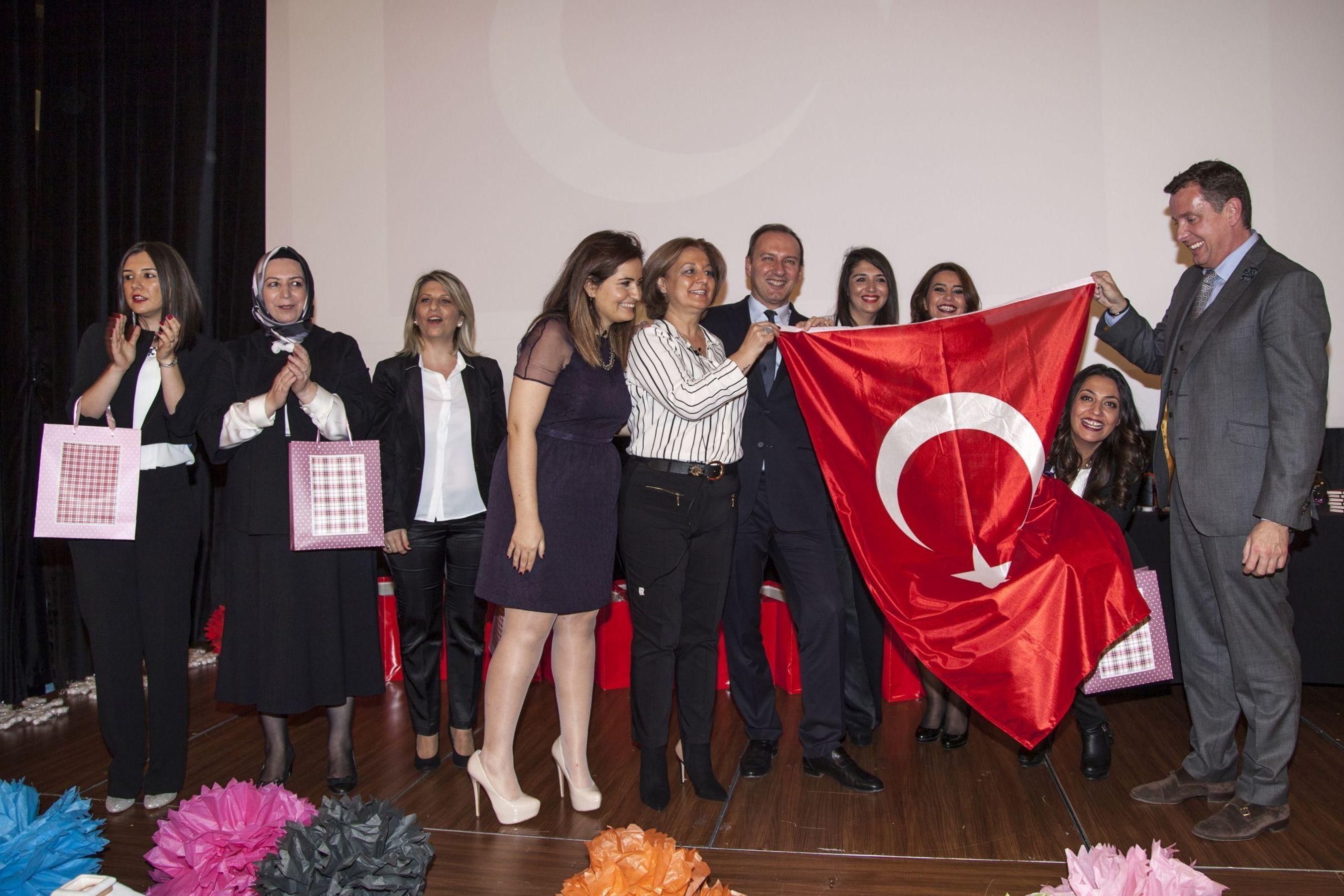PartyLite Turkey Opening Ceremony in Istanbul: Front middle: Elcin Birben, Hurcan Haydar (holding flag), Luca Pozzoli and Martin Kohler (holding flag) (PRNewsFoto/PartyLite)