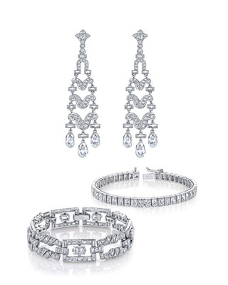Wedding day jewelry presented by Neil Lane as seen on last evening's ABC special, The Bachelor at 20: A Celebration of Love. Jade Roper was adorned with diamond and platinum bracelets as well as a set of round, baguette and briolette diamond chandelier earrings.
