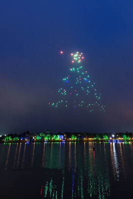 """Starbright Holidays - An Intel Collaboration at Disney Spring: This holiday season, guests at Disney Springs-the shopping, dining and entertainment district of Walt Disney World Resort-will get a chance to see Disney and Intel exploring remarkable new technology as hundreds of lighted show drones take to the nighttime sky in """"Starbright Holidays - An Intel Collaboration."""" (Matt Stroshane, photographer)"""