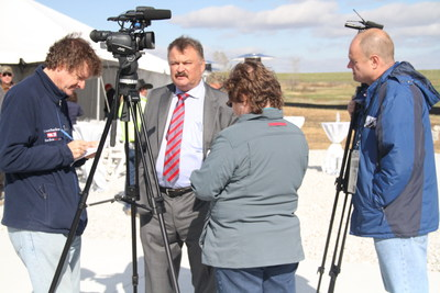 Rudi Roeslein discusses the largest livestock waste-to-energy project of its with reporters at Smithfield Hog Production's Ruckman Farm in Northwest Missouri. Roeslein announced the $120 million project will begin placing Renewable Natural Gas (RNG) into a national pipeline in Summer 2016.
