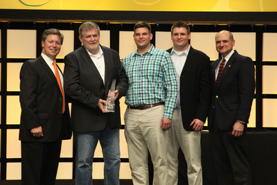 Jeff Warne (far left) President & CEO, Perkins & Marie Callender's, LLC. and Jim Frank (far right), SVP of Operations, Perkins Restaurants & Bakeries, present Jim Rahfaldt (2nd from left) with the Company's prestigious Franchisee of the Year award.  Rahfaldt, President of CyHawk Hospitality is joined by sons Nick Rahfaldt (center), Executive VP of Operations and Matt Rahfaldt (2nd from right), Executive Vice President of New Store Development.  (PRNewsFoto/Perkins & Marie Callender's, LLC)