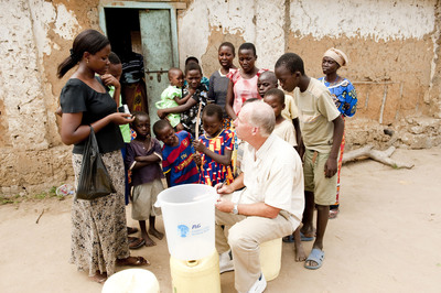 Dr. Greg Allgood, Director of P&G's CSDW, gives a PUR demonstration in Kenya.  (PRNewsFoto/Procter & Gamble)