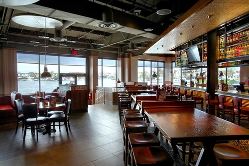 TGI Fridays new modern look creates a fun, energetic vibe with a dramatically redesigned bar as the focal ...