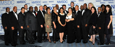 NMSDC President Joset B. Wright (center, black dress with white collar) presented the 2012 Corporation of the Year Award to Ford Motor Company at its the conclusion of its annual conference and business opportunity fair in Denver, Colorado, on October 31. Pictured directly to her right (front row) is Carla Preston of Ford and NMSDC Vice Chairman Shelley Stewart Jr. of DuPont. Also celebrating the award are Tony Brown, group vice president, Ford global purchasing (6th from the right), Ford purchasing and supplier diversity executives and a group of the company's minority suppliers.  (PRNewsFoto/National Minority Supplier Development Council)