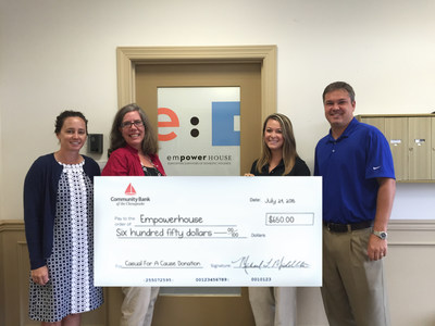Representatives from Community Bank of the Chesapeake present the donation check to Empowerhouse. From left to right: Diane Hicks, Assistant Vice President, Marketing Manager with Community Bank of the Chesapeake; Kathy Anderson, Executive Director, Empowerhouse; Laura Thessen, Commercial Loan Officer, Community Bank of the Chesapeake; and Ben Hall, Vice President, Commercial Loan Officer with Community Bank of the Chesapeake.