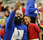 "BBVA Compass brand ambassador James Harden takes an ""elfie"" with a student at Houston ISD's Crespo Elementary during the kickoff of BBVA Compass' Project Blue Elf, its signature holiday initiative, which will promote financial literacy and deliver toys to 5,000 children at schools in 27 markets across the bank's footprint, including 430 kindergarten, first- and second-grade students at Crespo."