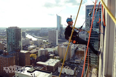 ExtremeTerrain Co-founder Andrew Voudouris shows fellow adventurers how it's done as he gets ready to rappel over 500 feet to the Philly streets.