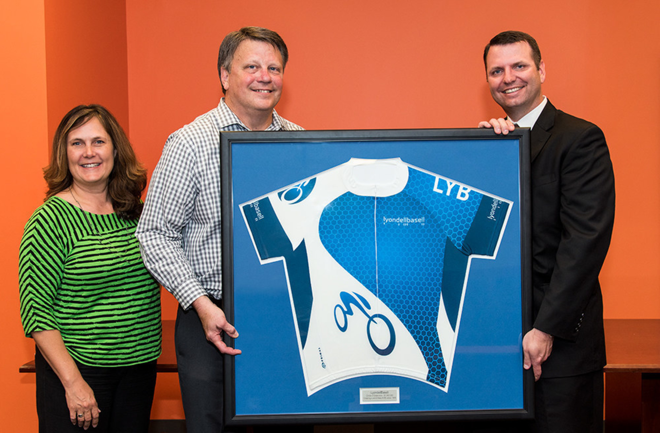 Kelli Dreiling, National MS Society vice president of development, and Mark Neagli, president of South Central Region MS Society, are presented with a LyondellBasell cycling team jersey from Jim Guilfoyle of LyondellBasell on Wednesday, April 27, 2016, in Houston. LyondellBasell received the Society's Circle of Distinction Award for raising $1.4 million through participation in the annual BP MS 150 bike ride. The jersey will hang in the Hall of Fame at the National MS Society offices in Houston.