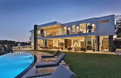An expansive new contemporary estate nestled in a private setting amid pristine canyons at 1740 Bel Air Road has been listed by Aaron Kirman, President of Aaroe Estates, the international luxury property division of John Aaroe Group, and Drew Fenton of Hilton and Hyland.