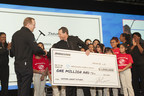 Stu Crum, president of Bridgestone Retail Operations (BSRO), presents Jim Clark, president and CEO of Boys & Girls Clubs of America, with a check for $1 million at the BSRO National Business Conference in Houston on Jan. 26, 2016.
