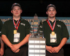 From l to r: Jake Edgerly and Ryan Herman, students at Washington Park High School in Racine, Wisconsin take home the National Automotive Technology Competition 1st Place Trophy.  (PRNewsFoto/New York International Auto Show)
