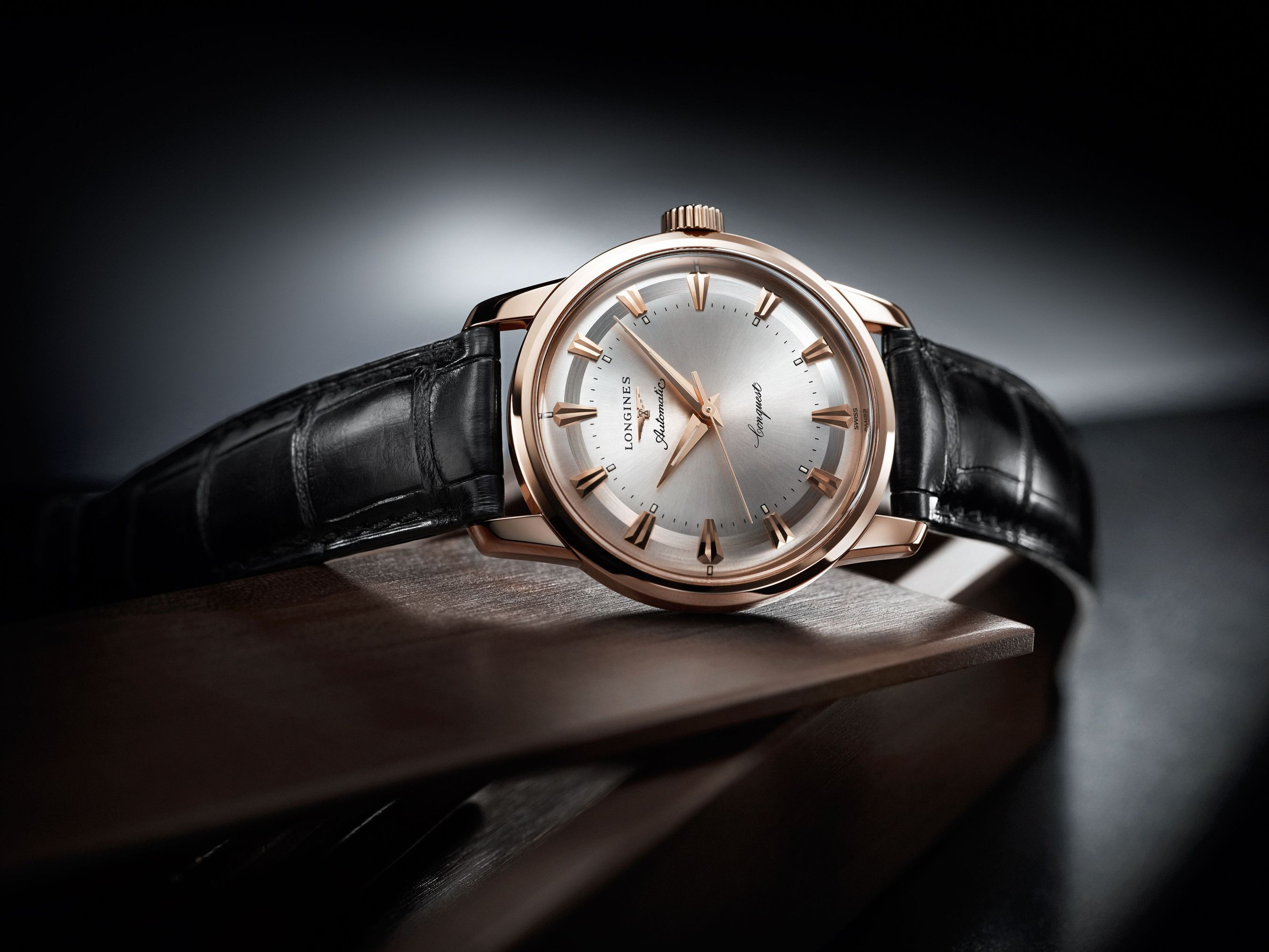 """This year, Longines celebrates the 60th anniversary of the filing of the patent for its """"Conquest"""" brand. To mark this occasion, the Swiss watch company is launching its Conquest Heritage 1954-2014. With a diameter of 35 mm, this model in rose gold displays a sunray silver dial with pink applied indices. Fitted with the mechanical calibre L633, it indicates the hours, the minutes and the seconds. The caseback is screwed down and decorated with a gold and enamel medallion representing a constellation. This timepiece is numbered and limited to 60 pieces. (PRNewsFoto/Longines)"""