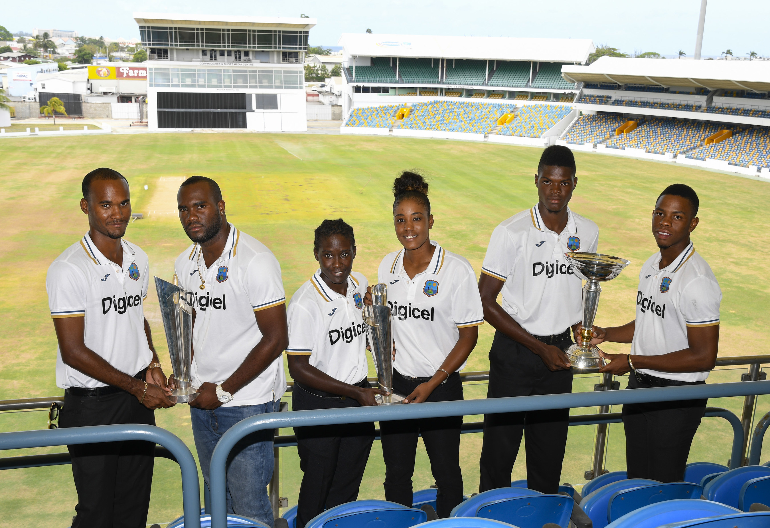 Members of the West Indies Cricket teams pose with their champion trophies: Kraigg Brathwaite and Ashley Nurse from the Men's team, Kycia Knight and Hayley Matthews from the Women's team and Alzarri Joseph and Shimron Hetmyer from the Under-19 team.