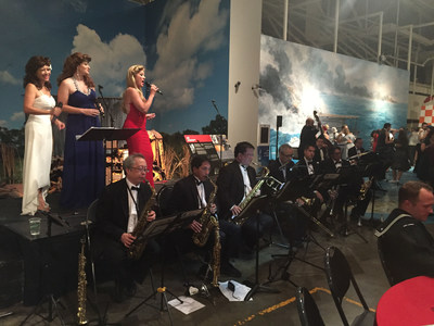 Injured service members and their families enjoy swing music at 1940's themed event.