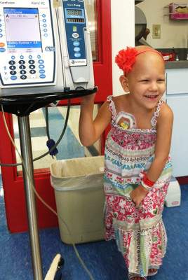 """Donations made during St. Joseph's Children's Hospital's """"Christmas in July"""" drive will help provide a momentary escape from illness for patients like 5-year-old Haley Boyd, who has been battling cancer for half of her life.  (PRNewsFoto/St. Joseph's Children's Hospital)"""