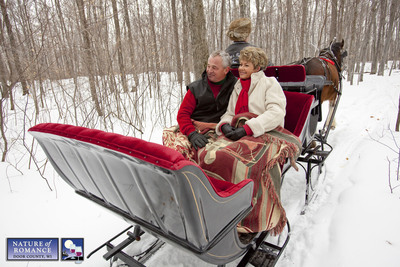 A couple enjoys a romantic winter sleigh ride with Mayberry's Carriages at Orchard Country Winery near Fish Creek in Door County, Wisconsin.  (PRNewsFoto/Door County Visitor Bureau, Mike Roemer/DoorCounty.com)