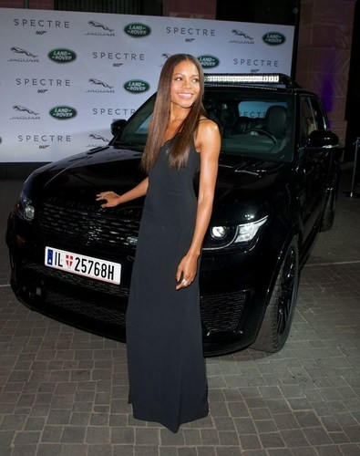 Spectre cast members Naomie Harris and David Bautista are reunited with Jaguar and Land Rover stunt vehicles from the film ahead of their international debut in Frankfurt, Germany (PRNewsFoto/Jaguar Land Rover) (PRNewsFoto/Jaguar Land Rover)