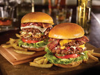 TGI Fridays raises its burgers to new heights...literally. Fridays new, craveable burger menu includes a trio of Stacked Burgers, showcasing two 100% fresh, never frozen, USDA Choice beef burger patties served with freshly-baked, buttery, brioche-style buns.  (PRNewsFoto/TGI Fridays)