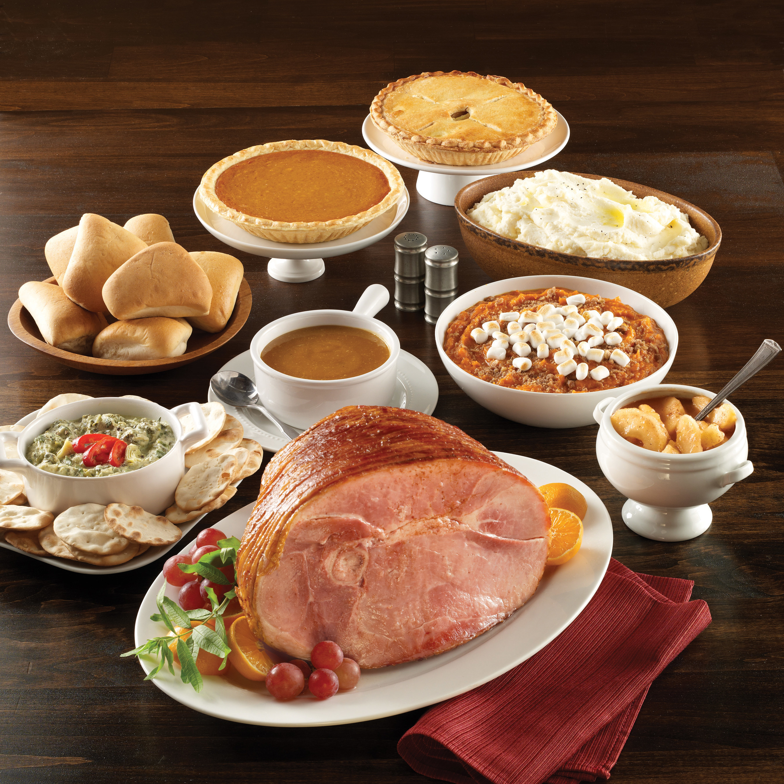 Thanksgiving catering offerings from Boston Market vary and start at $10.29 per person. Guests can choose from boneless honey glazed ham, boneless roasted turkey or signature rotisserie chicken with a choice of sides and a pie.