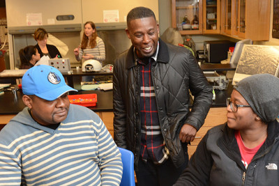 GZA chatting with students about DNA models they were constructing.