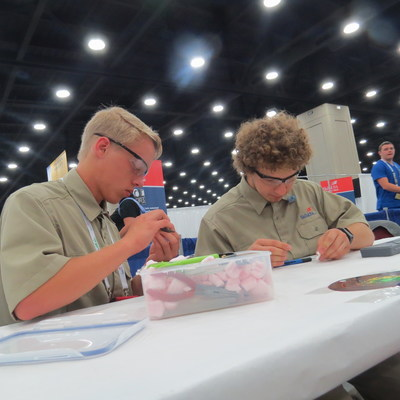 SkillsUSA Additive Manufacturing Competition contestants Justin Heck (left) and Christopher Dagher (right), from Payette River Technical Academy in Emmett, Idaho, arrived early on day 3 of the contest to prep their designs for judging. Heck and Dagher won the gold medal, ranking in the top spot of the high school participants.