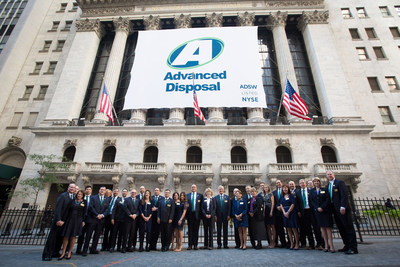 The Advanced Disposal leadership team and IPO attendees in front of the New Your Stock Exchange facade on October 6, 2016.
