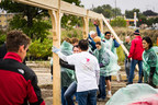 Astellas Pharma US employees help build a shelter at a conservation area on Sept. 12, 2014.