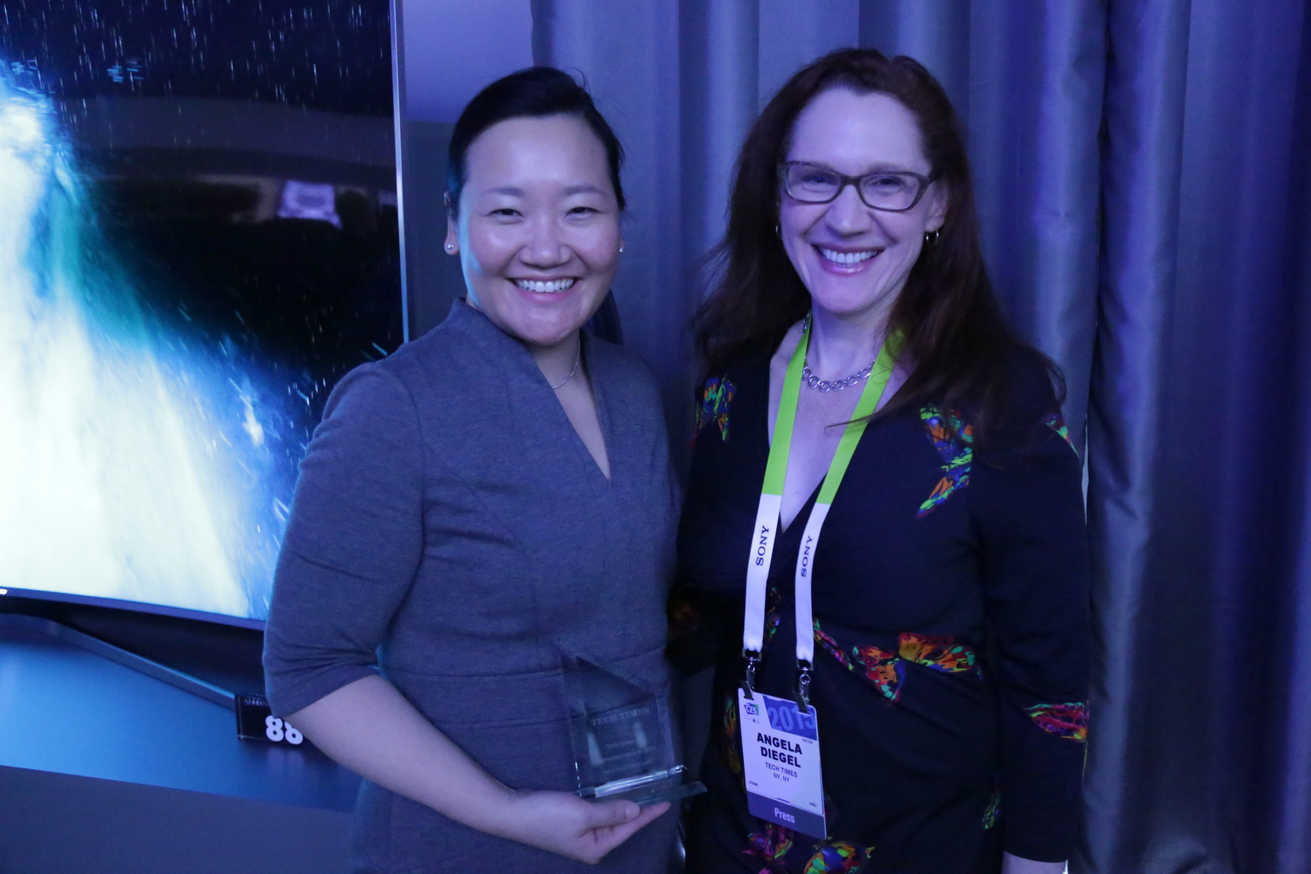 """Tech Times announced Samsung Electronics as one of the recipients of Tech Times '10' Innovation Awards 2015. The winning products """"have the potential to impact consumers in a positive way, and we expect them to resonate immediately with our readers,"""" said Tech Times President Angela Diegel (right)."""