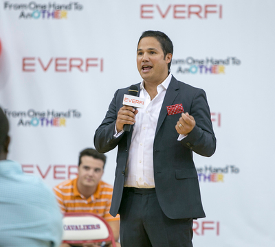 EverFi Co-Founder Ray Martinez thanks Pharrell Williams and his educational non-profit, From One Hand to AnOther, for providing STEM education and mentorship opportunities to local students. (PRNewsFoto/EverFi, Inc., Keith Cephus)