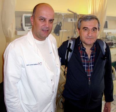 Heart surgeon Dr. Ivan Knezevic is pictured with Slovenia's first Total Artificial Heart patient Nikola Gaspic. On Dec. 29, 2011, Mr. Gaspic was discharged from UMC Ljubljana to wait for a matching donor heart at home wearing the Freedom(R) portable driver that powers his Total Artificial Heart in the Backpack.  (PRNewsFoto/SynCardia Systems, Inc.)
