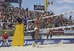 Three-time Olympic gold medalist, Kerri Walsh Jennings goes up for a block at the 2014 ASICS World Series of Beach Volleyball