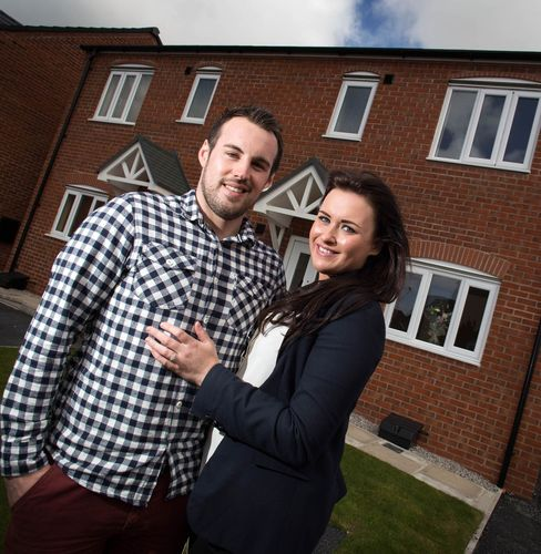 Taylor Wimpey - Nikolai Ivanovic and Catherine McClean the UK's first Help to Buy purchasers (PRNewsFoto/Taylor Wimpey)