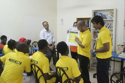 Financial Literacy training and handbook were designed specifically to fit the needs of laborers. In the Photo trainers are conducting the training in one of the laborers' accommodations in the UAE (PRNewsFoto/The Western Union Company)