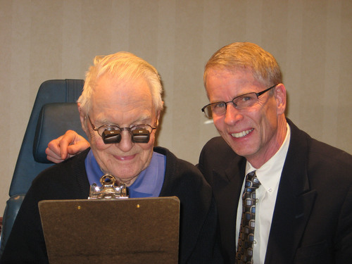 Dr. Kinkade with a patient wearing a Spectacle Miniature Telescope.  (PRNewsFoto/Low Vision Consulting)