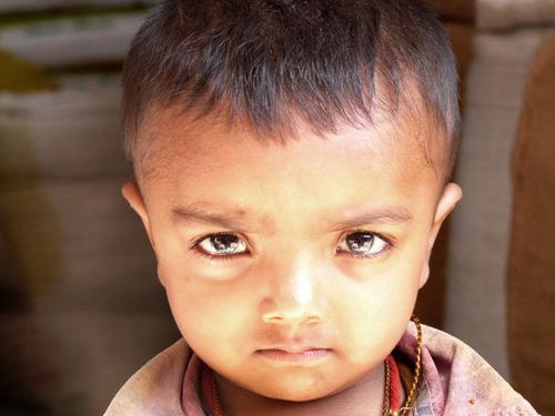 Dark Eyes - Serious Young Man. (PRNewsFoto/Himalayan Stove Project) (PRNewsFoto/HIMALAYAN STOVE PROJECT)